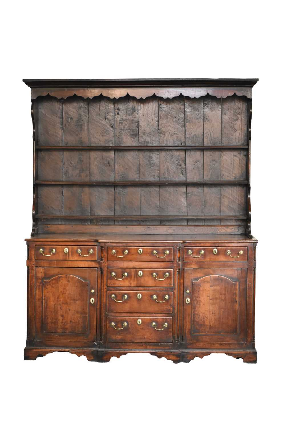 A late 18th century fruitwood or yew wood breakfront dresser, North Wales