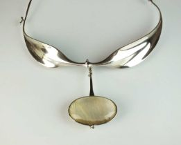A Georg Jensen silver neck ring and rutilated quartz pendant designed by Vivianna Torun Bulow-Hube