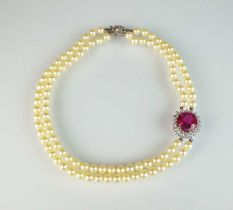 A pink tourmaline and diamond cluster on two strand cultured pearl necklace