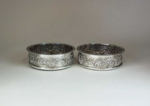 A pair of late Victorian silver mounted Magnum wine coasters