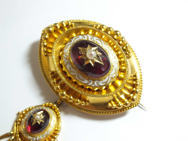 A Victorian garnet, pearl and enamel locket brooch - Image 3 of 14