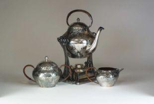 A Jugendstil three piece silver plated tea service by Moritz Hacker,