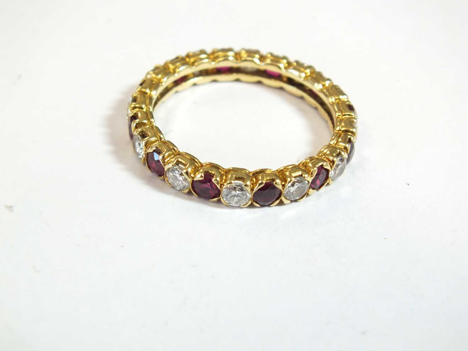 An 18ct gold ruby and diamond full eternity ring by Boucheron - Image 7 of 8