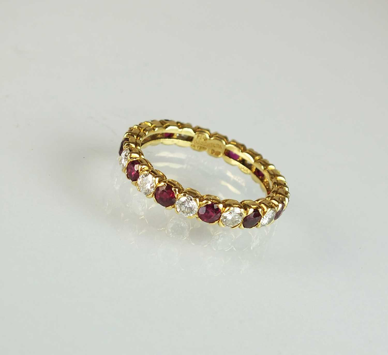 An 18ct gold ruby and diamond full eternity ring by Boucheron