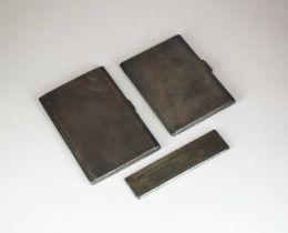 Two silver cigarette cases and a silver comb