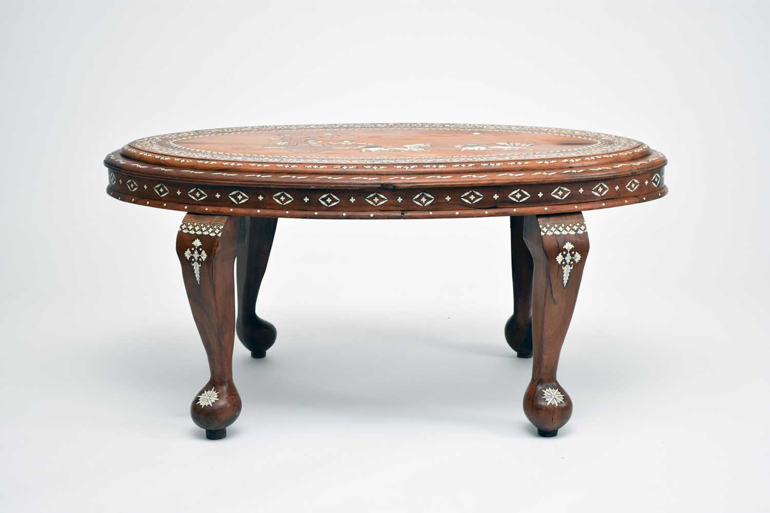 A good, late 19th/early 20th century Indian, teak occasional table, profusely inlaid