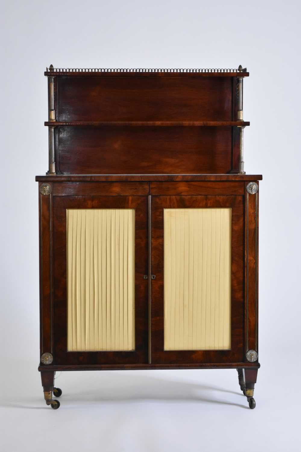 An early 19th century rosewood veneered bookcase