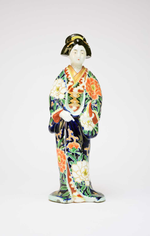 A Japanese porcelain figure of a bijin