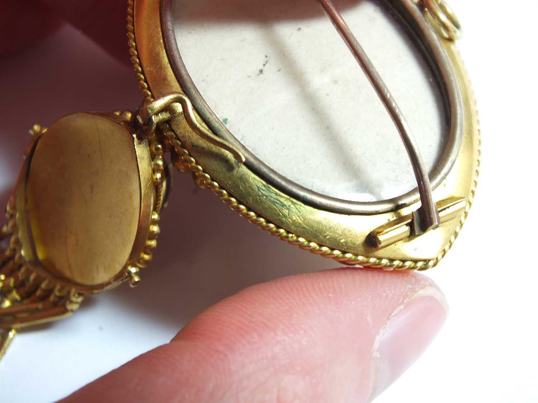 A Victorian garnet, pearl and enamel locket brooch - Image 9 of 14