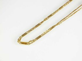 A two strand yellow metal chain necklace