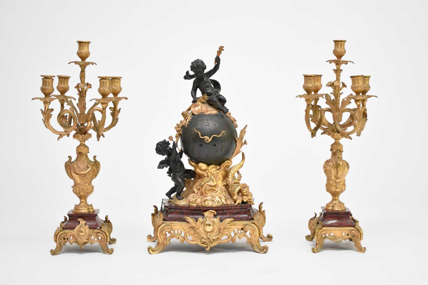 A late 19th/early 20th century, French, Rococo style, ormolu and marble mantel clock garniture