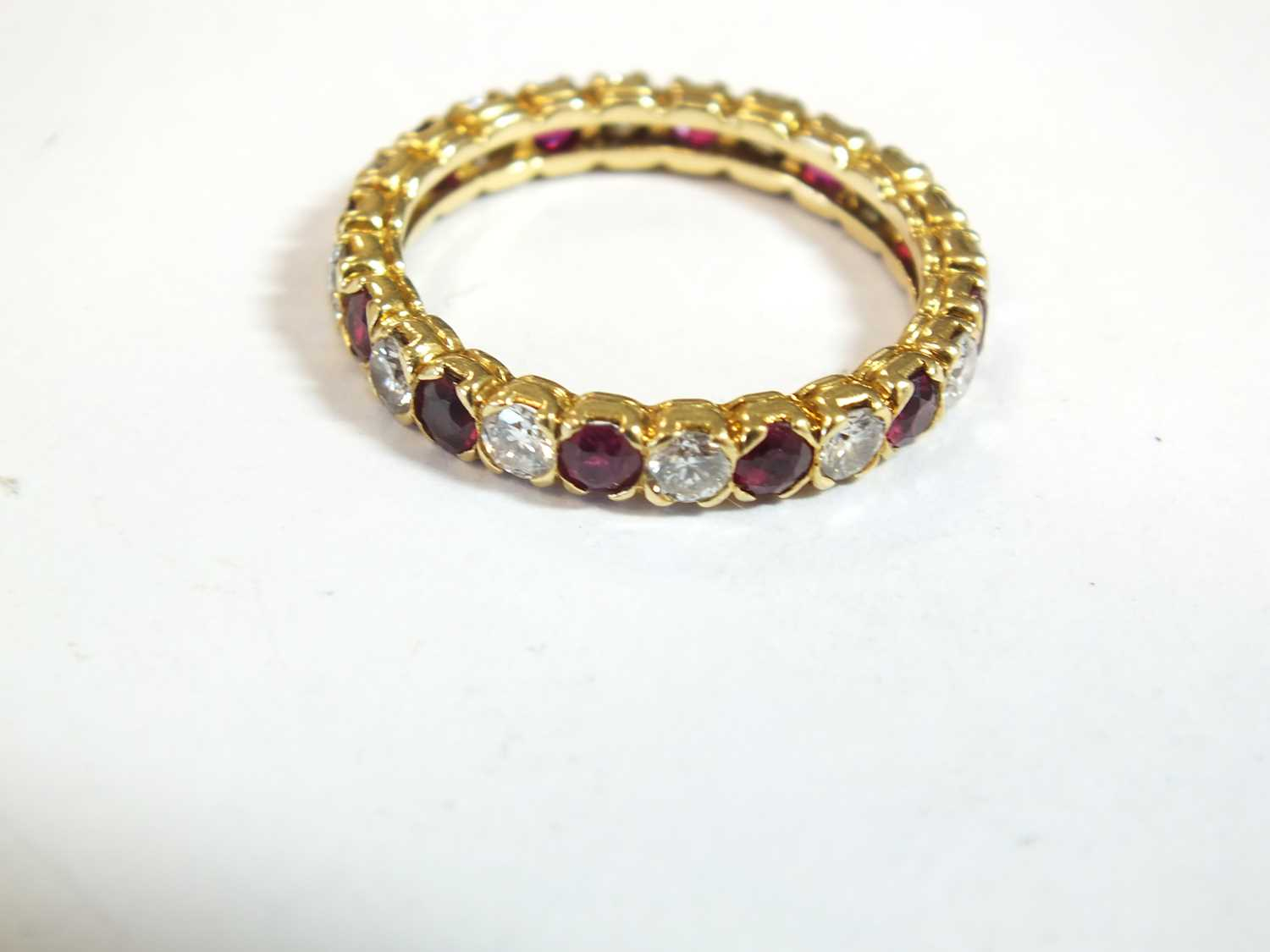 An 18ct gold ruby and diamond full eternity ring by Boucheron - Image 6 of 8