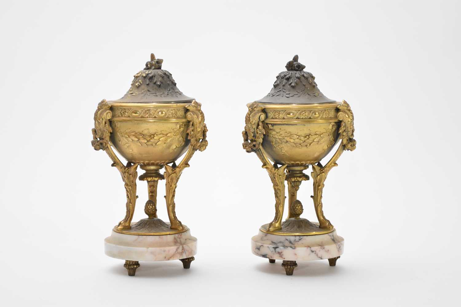 A pair of gilt metal and white veined marble urns and covers, circa 1900