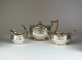 A three piece silver tea service