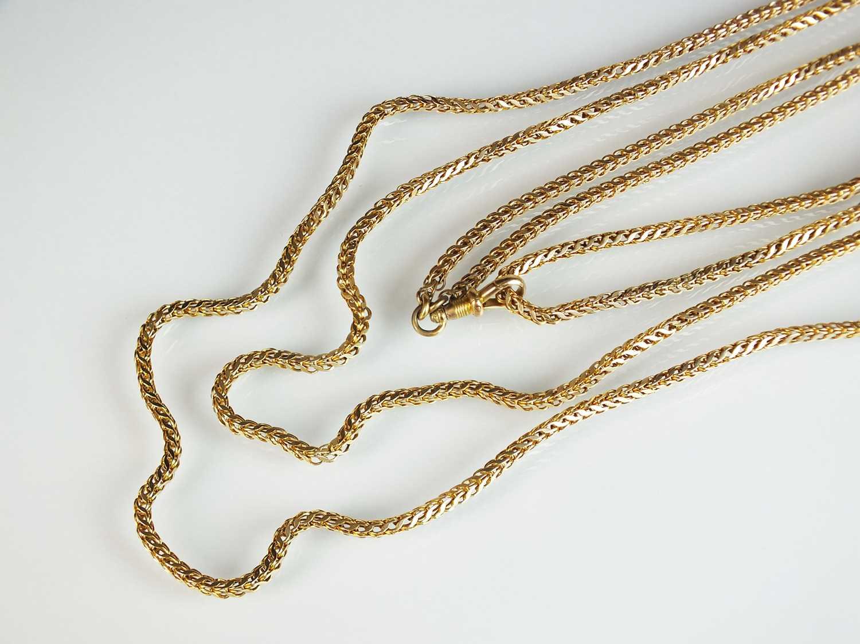 A yellow metal guard chain