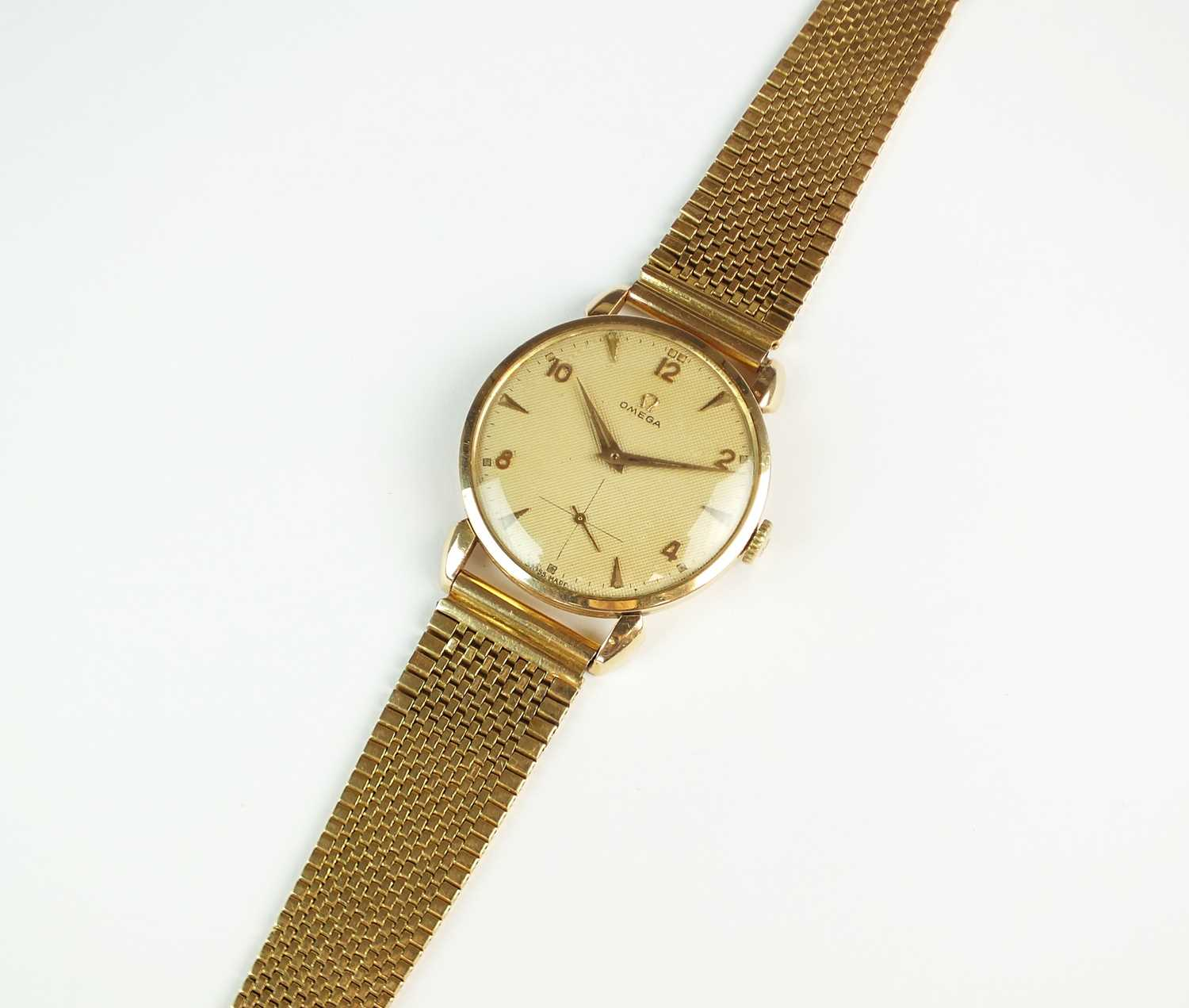 A Gentleman's gold plated Omega wristwatch with yellow metal bracelet