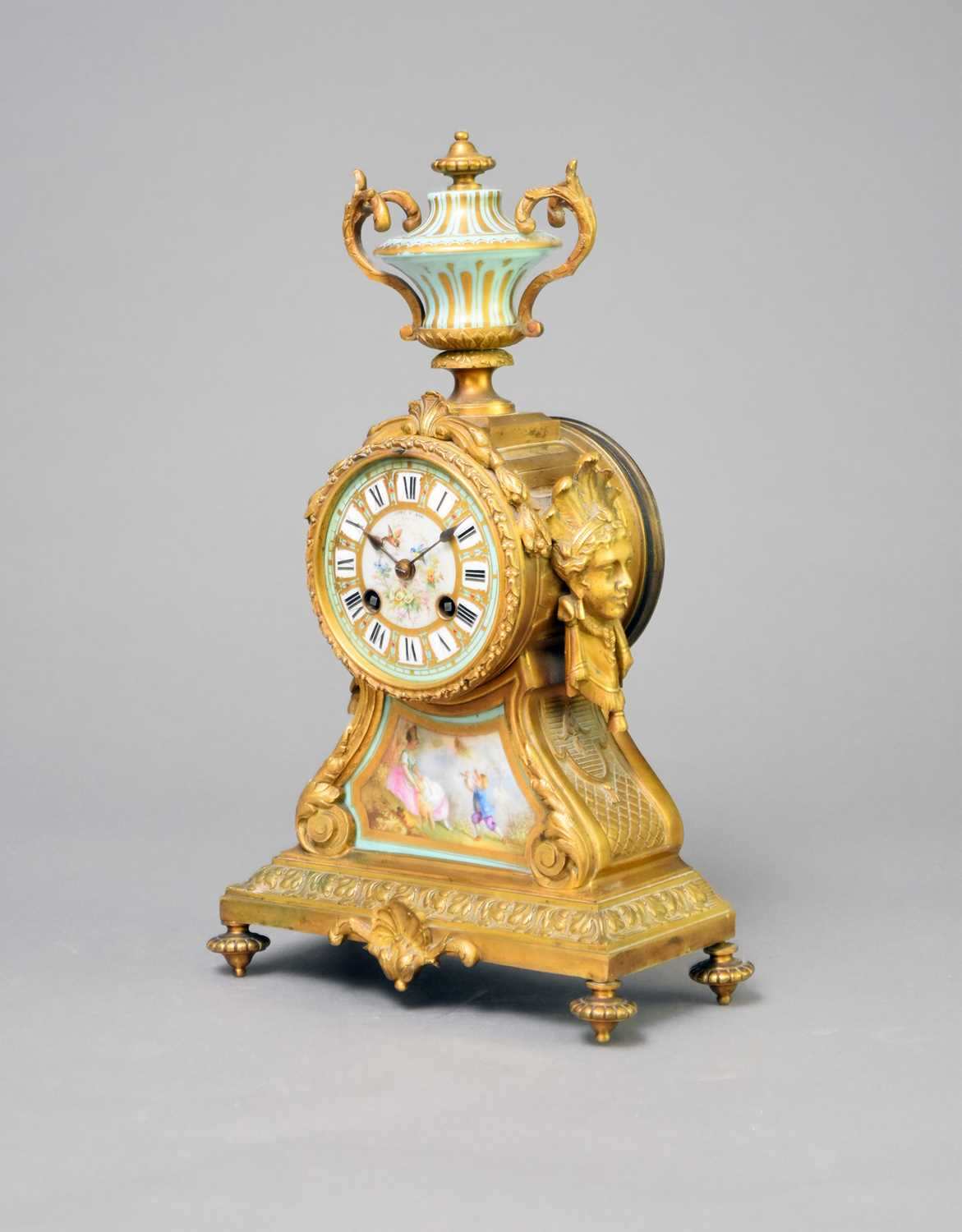 A late 19th century French, porcelain mounted, gilt metal mantel clock