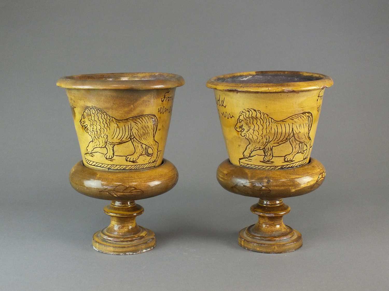 A pair of Buckley slipware flower pots