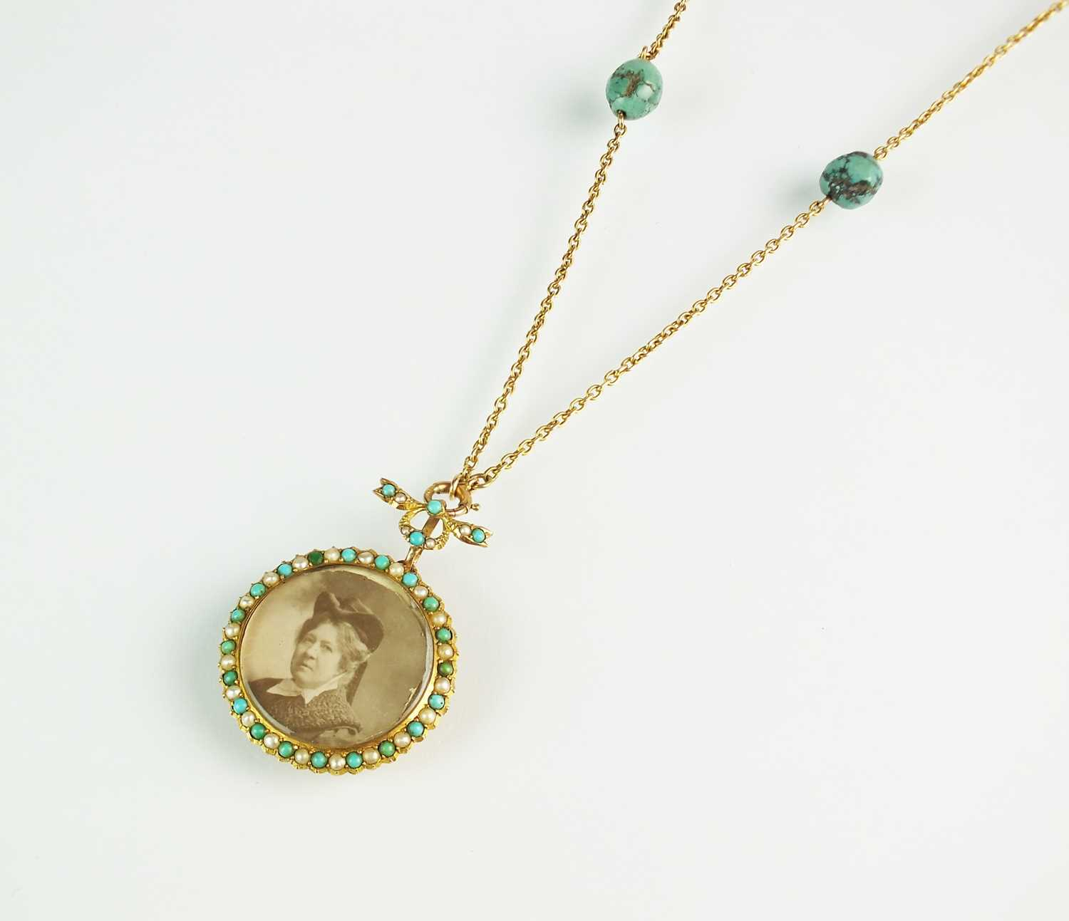 A turquoise and split pearl circular locket pendant