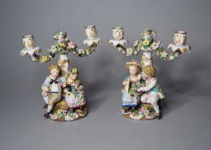 A pair of John Bevington porcelain figural candelabra
