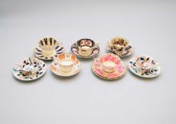 A group of English porcelain teacups and saucers, early-mid 19th century including Coalport