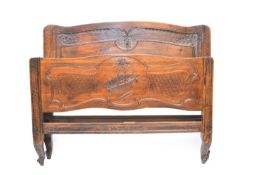 A French Louis XV style mahogany bedstead
