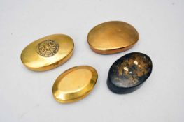 Four oval snuff boxes comprising a papier-mache example, a brass miner's tobacco pouch, a J.S