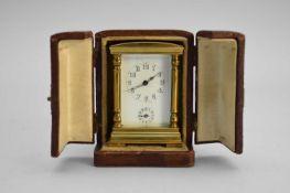 A French gilt brass miniature carriage alarm clock