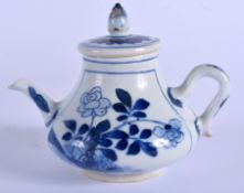 A 17TH/18TH CENTURY CHINESE BLUE AND WHITE TEAPOT AND COVER Kangxi/Yongzheng, painted with flowers.