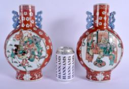 A VERY RARE PAIR OF 19TH CENTURY CHINESE TWIN HANDLED PORCELAIN MOON FLASKS Kangxi Style, enamelled