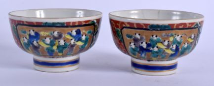 A PAIR OF 19TH CENTURY JAPANESE MEIJI PERIOD AO KUTANI TEABOWLS painted with figures and landscapes.