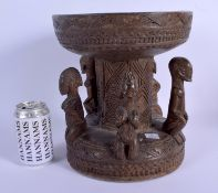AN EARLY 20TH CENTURY AFRICAN DOGON TRIBAL STOOL formed with five opposing figures. 28 cm x 20 cm.