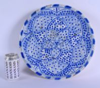 A 19TH CENTURY ARTS AND CRAFTS PERSIAN MIDDLE EASTERN BLUE AND WHITE DISH. 31 cm diameter.