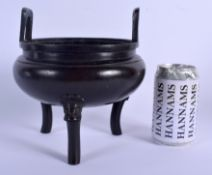 A 19TH CENTURY CHINESE TWIN HANDLED BRONZE CENSER Qing, bearing Xuande marks to base. 17 cm x 19 cm.