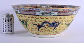A LARGE 1930S CHINESE FAMILLE JAUNE PORCELAIN PUNCH BOWL Late Qing/Republic, painted with dragons an