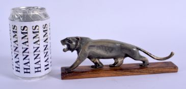 A 19TH CENTURY CONTINENTAL CARVED RHINOCEROS HORN FIGURE OF A TIGER modelled upon a hardwood plinth.