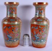 A FINE LARGE PAIR OF 19TH CENTURY CHINESE FAMILLE ROSE PORCELAIN ROULEAU VASES Daoguang, painted wit