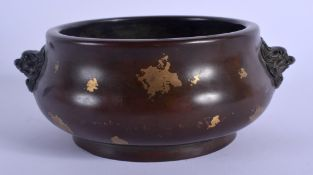 A CHINESE QING DYNASTY GOLD SPLASH BRONZE CENSER with Buddhistic lion handles. 15 cm wide, internal