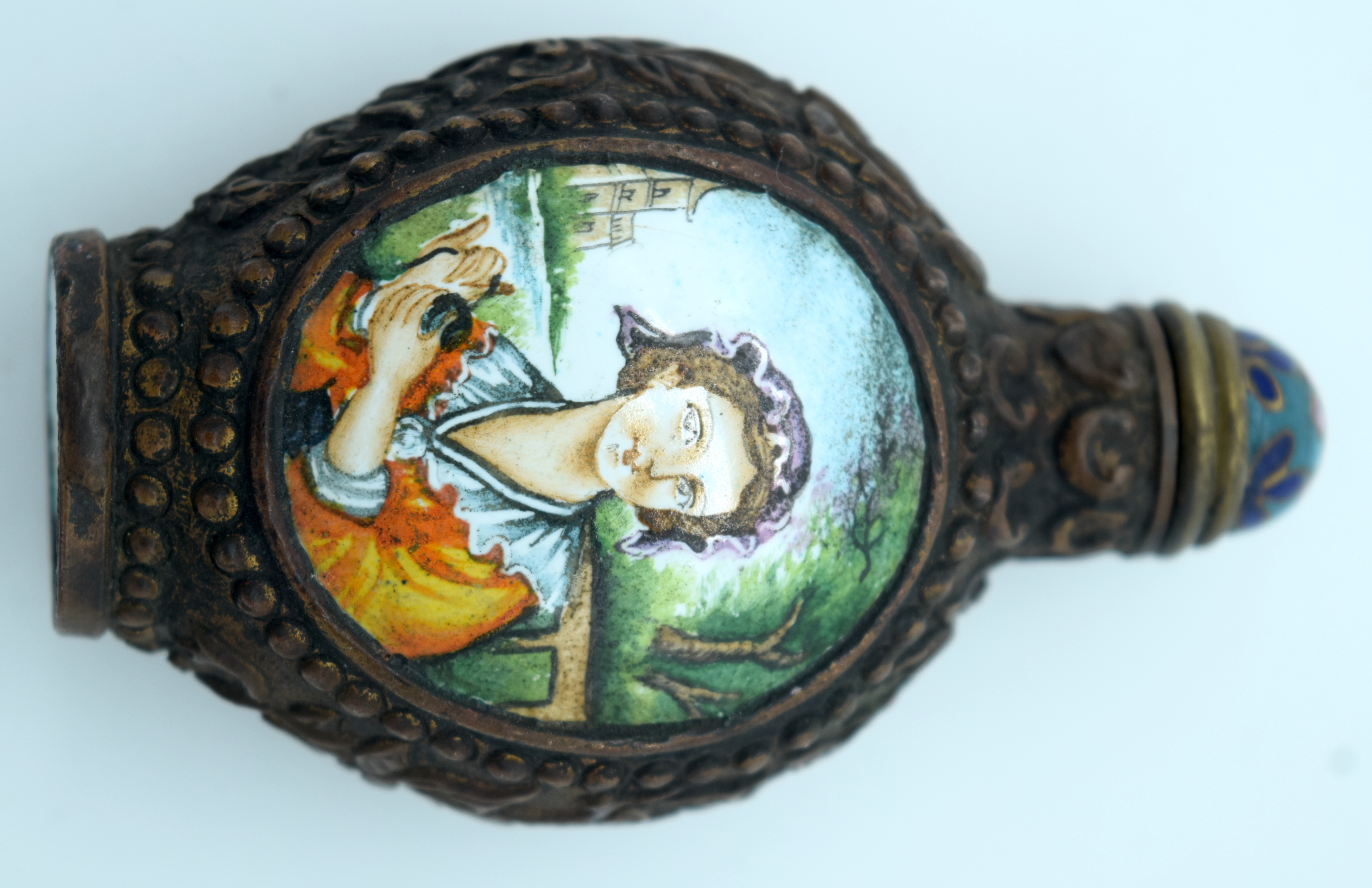 A metal snuff bottle with an enamelled painted picture of a woman 8 x 5cm. - Image 2 of 3