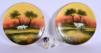 A RARE PAIR OF ROYAL ALBERT PORCELAIN DOG PLATES together with a bisque figure of a dog. Plate 21 cm