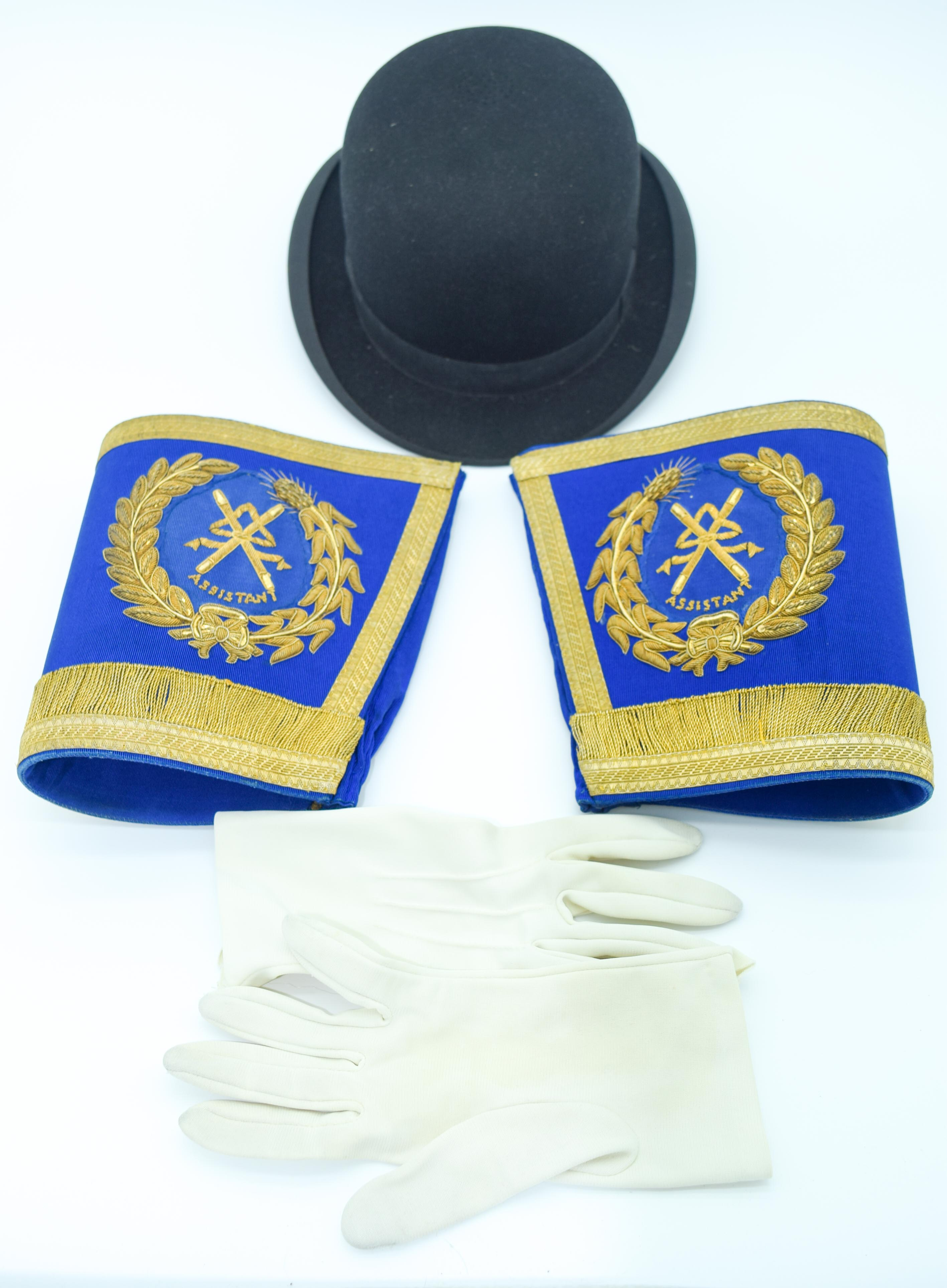 A Pair of vintage Cuff Braids, gloves and a bowler hat (3) .
