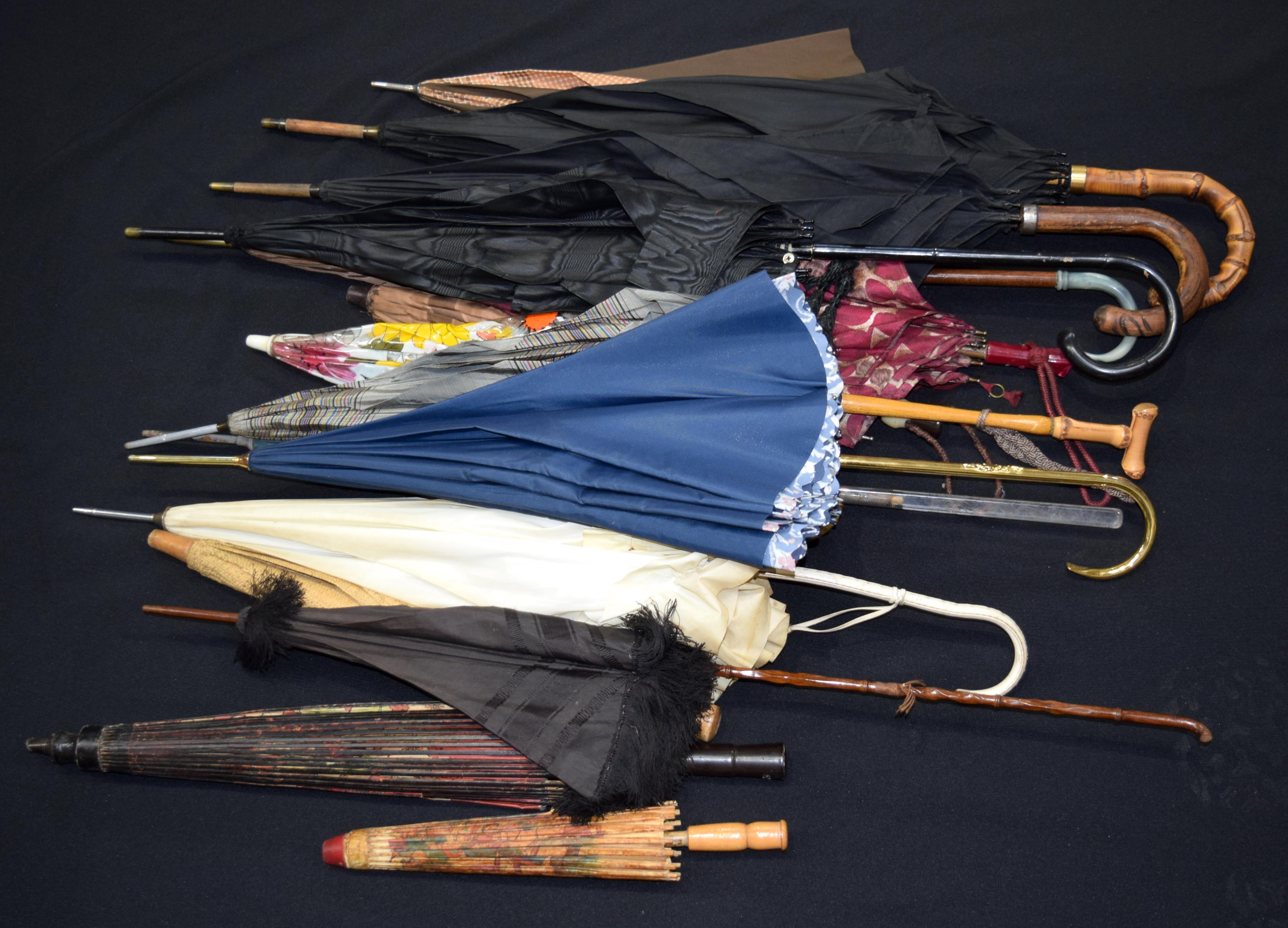 A large quantity of vintage parasols and umbrellas. (Qty)