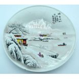 A Chinese plate celebrating 1973 decorated with a snowy landscape.