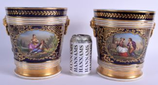 A LARGE PAIR OF 19TH CENTURY FRENCH PORCELAIN CACHE POTS painted with romantic scenes upon a rich bl