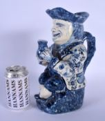 AN ANTIQUE DUTCH BLUE AND WHITE DELFT POTTERY TOBY JUG modelled as a male holding an ale jug. 27 cm