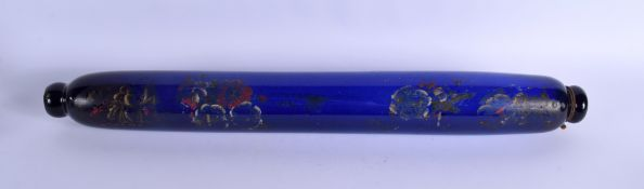 A LONG ANTIQUE BRISTOL BLUE ROLLING PIN painted with flowers. 68 cm long.