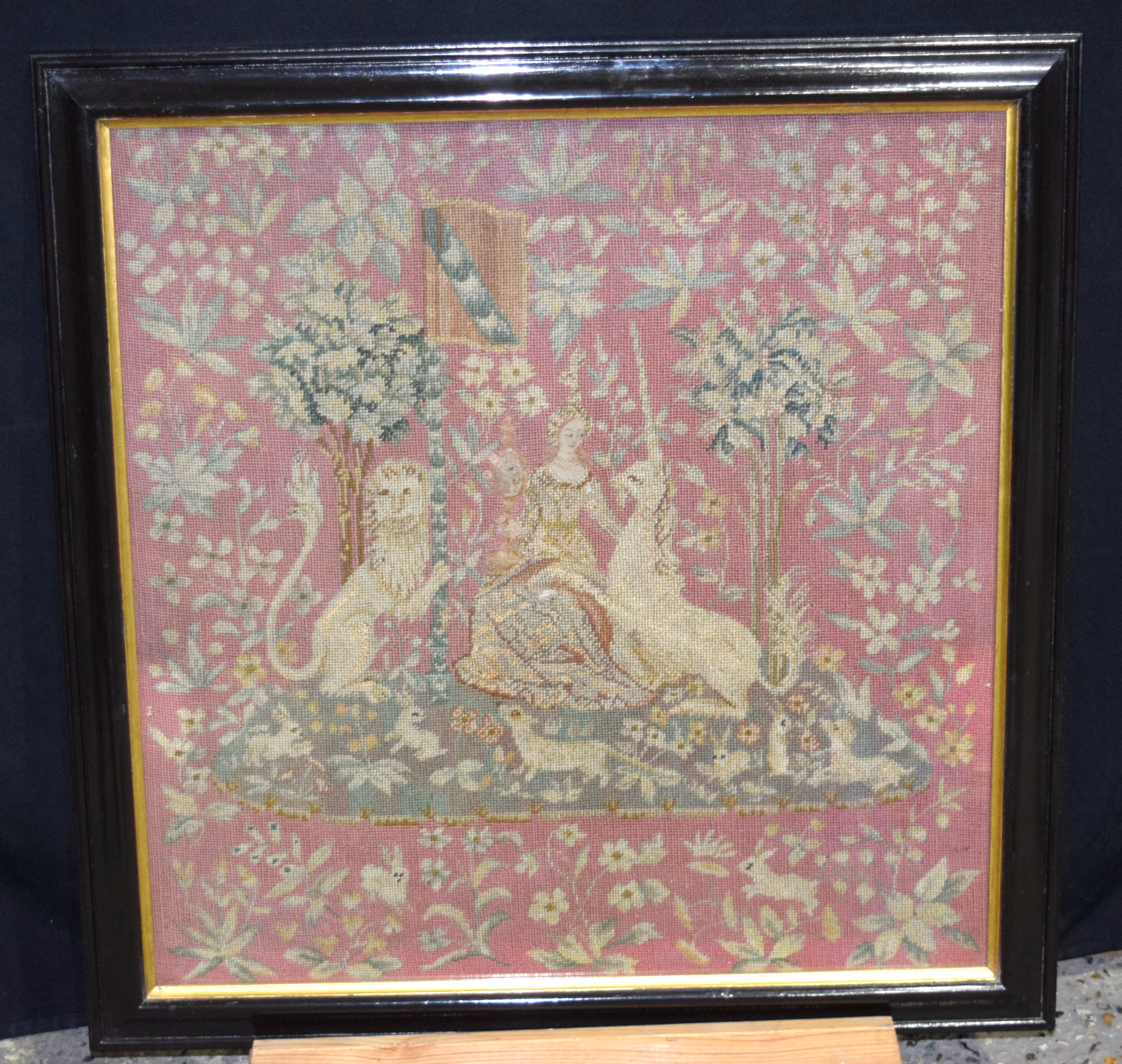 Framed tapestry of a Queen showing a standard and unicorn 94 x 56cm..
