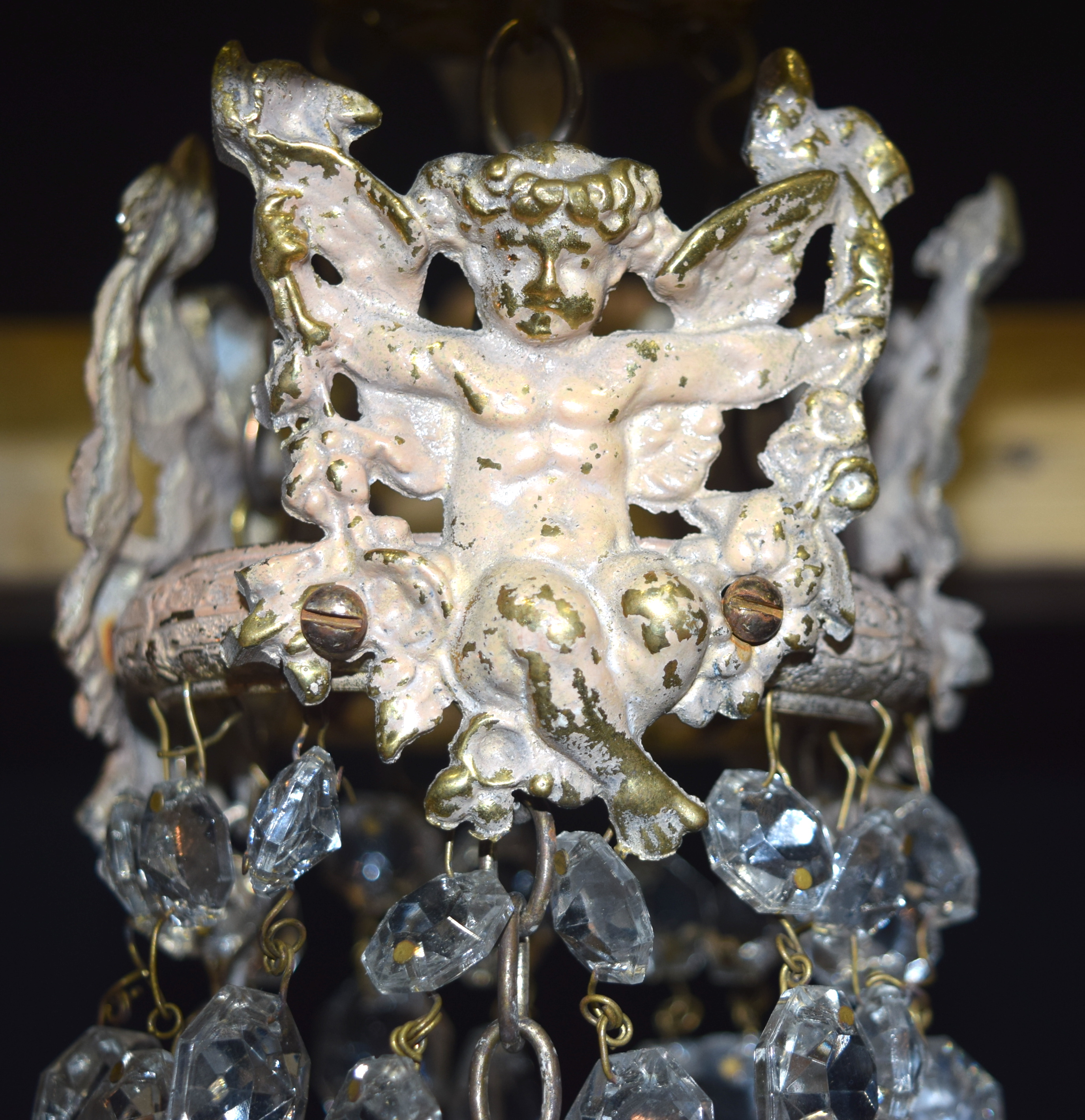 A 5 tier crystal glass chandelier with a cage of crystal and Cherubs 56 x 21cm