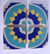 A SET OF FOUR MIDDLE EASTERN MULTAN BLUE AND YELLOW GLAZED TILES. Each 15 cm square. (4)