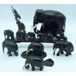 A collection of hardwood Indian and African Elephants 25 x 20cm (7).